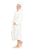 Full length portrait of happy young woman in bathrobe