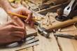 Leinwanddruck Bild - carpenter working,hammer and meter on construction background