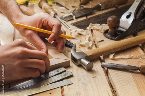 Leinwanddruck Bild carpenter working,hammer and meter on construction background