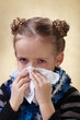 Little girl with the flu - blowing nose