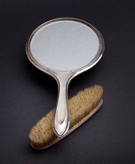 silver mirror and comb