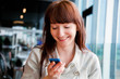 Beautiful business woman talking on mobile phone and smiling
