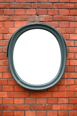 Blank ceramic frame on brick wall