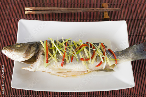 Chinese style steamed sea bass with ginger, chili & spring onion
