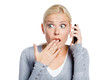 Speaking on phone shocked girl covers her mouth with hand