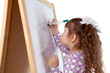Girl draws on board, indoor