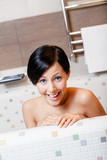 Lady relaxes in bath, hygiene concept