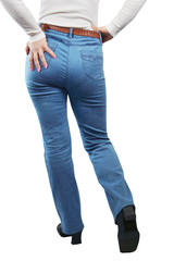 Female Legs Dressed In Blue Jeans. View From The Back
