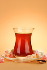 glass of Turkish tea and rahat Delight, on beige background