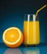 Delicious orange juice in glass and orange next to it