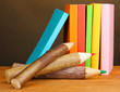 Colorful wooden pencils with books