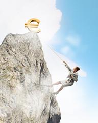businesswoman climbing mountain