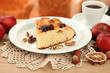 slice of tasty homemade pie with jam and apples and cup of