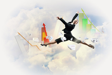 businesswoman in black suit jumping