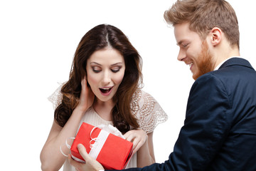 Young man amazes his pretty girlfriend with present
