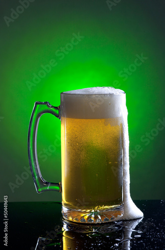Foamy mug of beer.