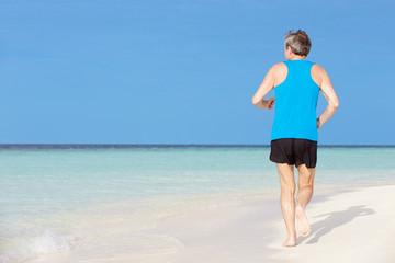Senior Man Running On Beautiful Beach