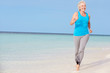 Senior Woman Running On Beautiful Beach
