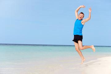 Senior Man Jumping On Beautiful Beach