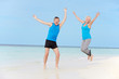 Senior Couple Jumping On Beautiful Beach