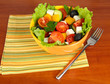 Tasty Greek salad on wooden background