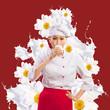 Asian female cook against milk splashes
