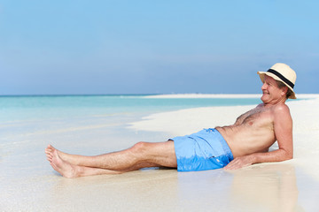 Senior Man Enjoying Beach Holiday