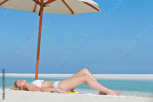 Woman Sunbathing On Beautiful Beach Holiday