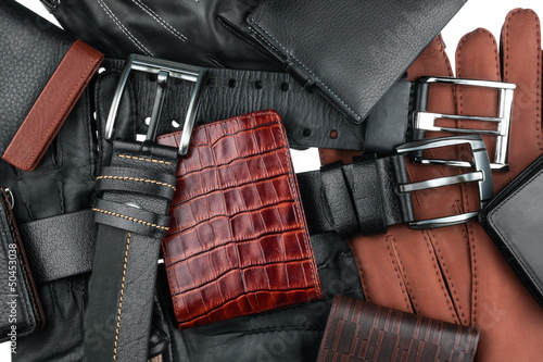Men's wallet lying on the belts and gloves