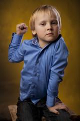 boy threatens a fist