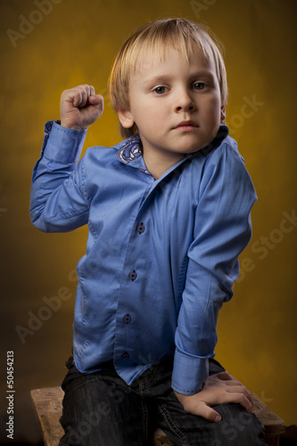 boy threatens a fist