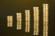 Many coins in columns on dark background