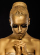Belief. Styled Woman with praying hands. Golden Makeup