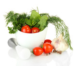 Composition of mortar, tomatoes and green herbals, isolated