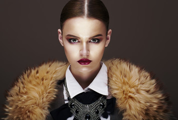 Beautiful Fashionable Strict Fashion Model in Fur Coat. Luxury