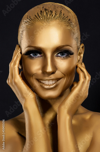 Coloring. Gorgeous Woman smiling. Fantastic Golden Makeup. Art