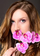 attractive woman with a orchid and beautiful makeup