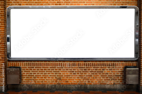Huge empty billboard on brick wall