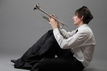 Portrait of a young man and his Trumpet music lover