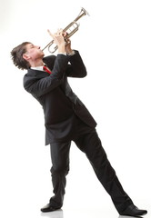 Portrait of a young man playing his Trumpet plays isolated