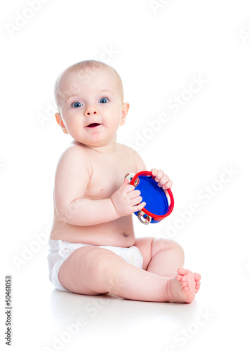 Baby girl playing musical toy isolated on white
