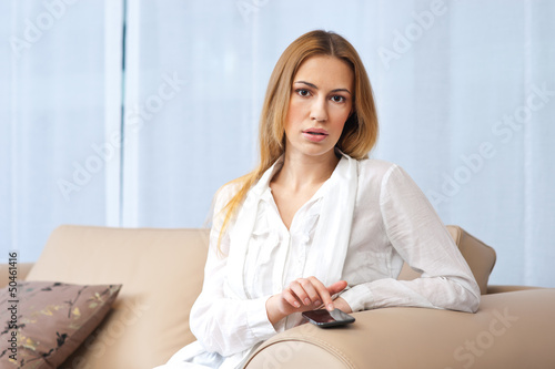 woman with smartphone in her home