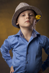 bly in a hat and yellow tulip