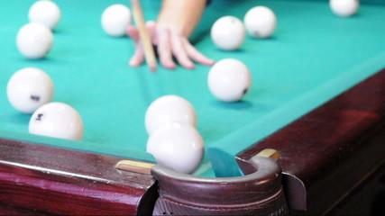 Playing pool, hitting the balls