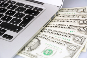laptop keyboard and money