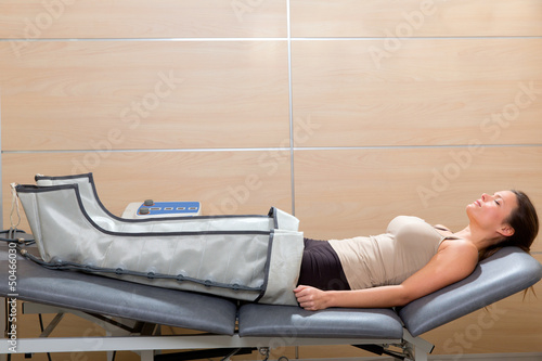 legs pressotherapy machine on woman patient in hospital - 50466030