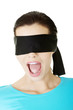Portrait of a young blindfold woman screaming