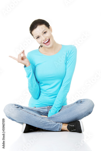 Happy , excited young woman pointing on copy space