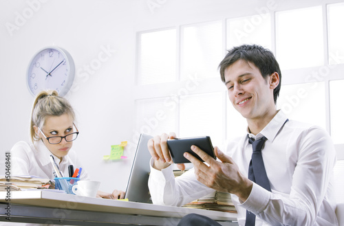 businessman using smart phone in office