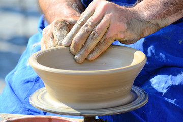 Hands Making Pottery On A Wheel